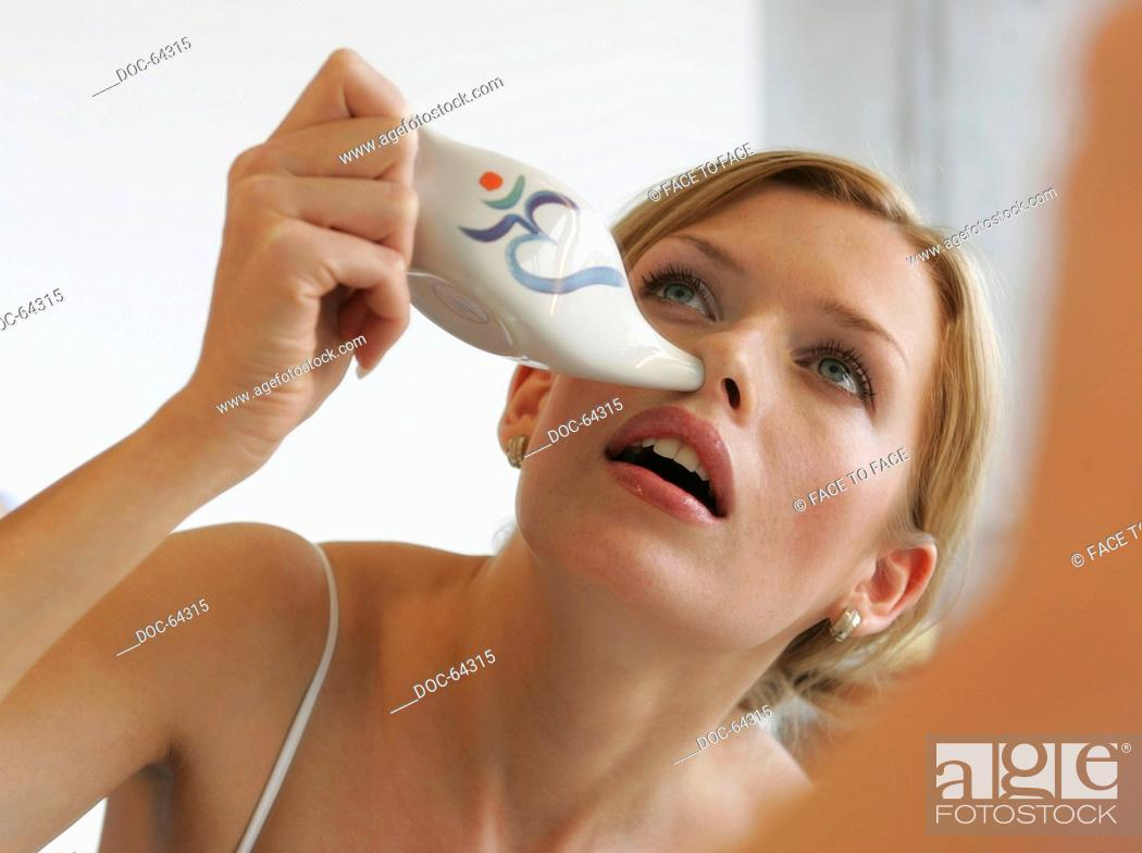 e3f2e9bf1e4 young adult woman makes nasal douche, Stock Photo, Picture And ...