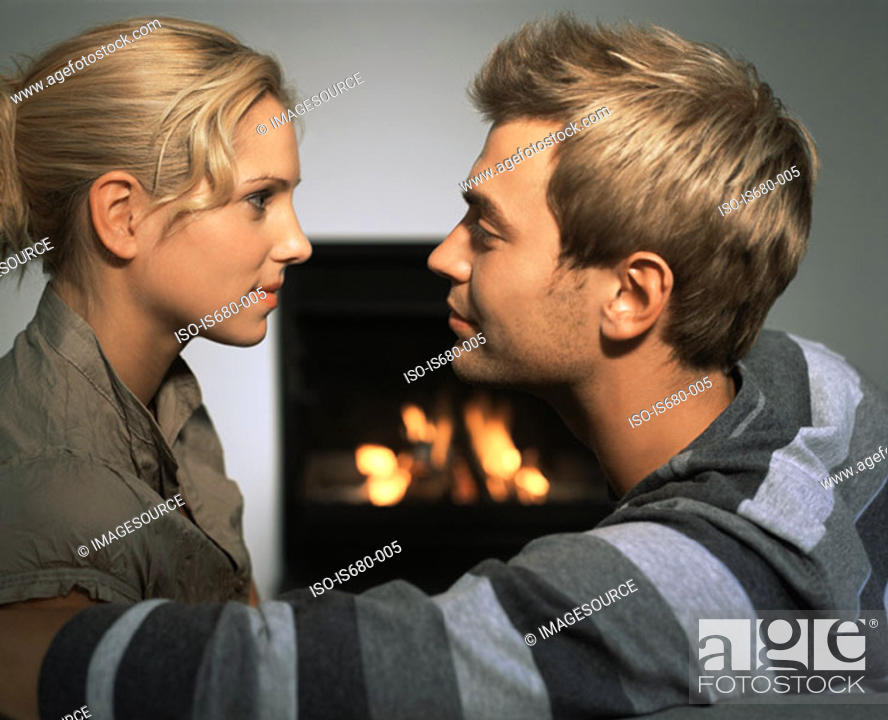 Stock Photo: Couple by a fire.