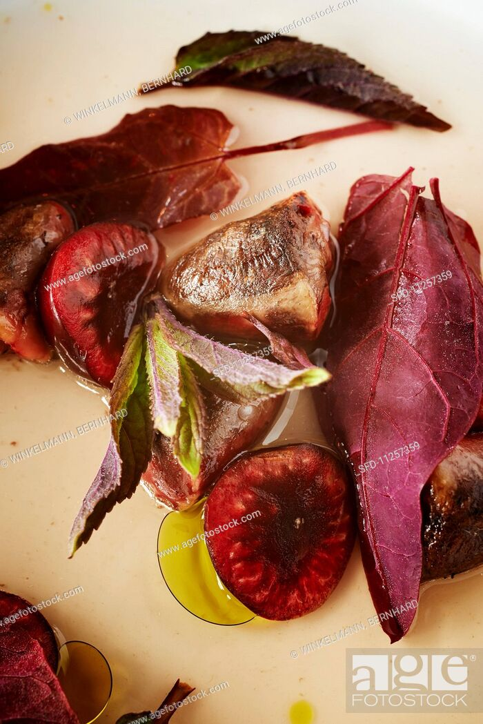 Stock Photo: Roasted pigeon hearts with cherries.
