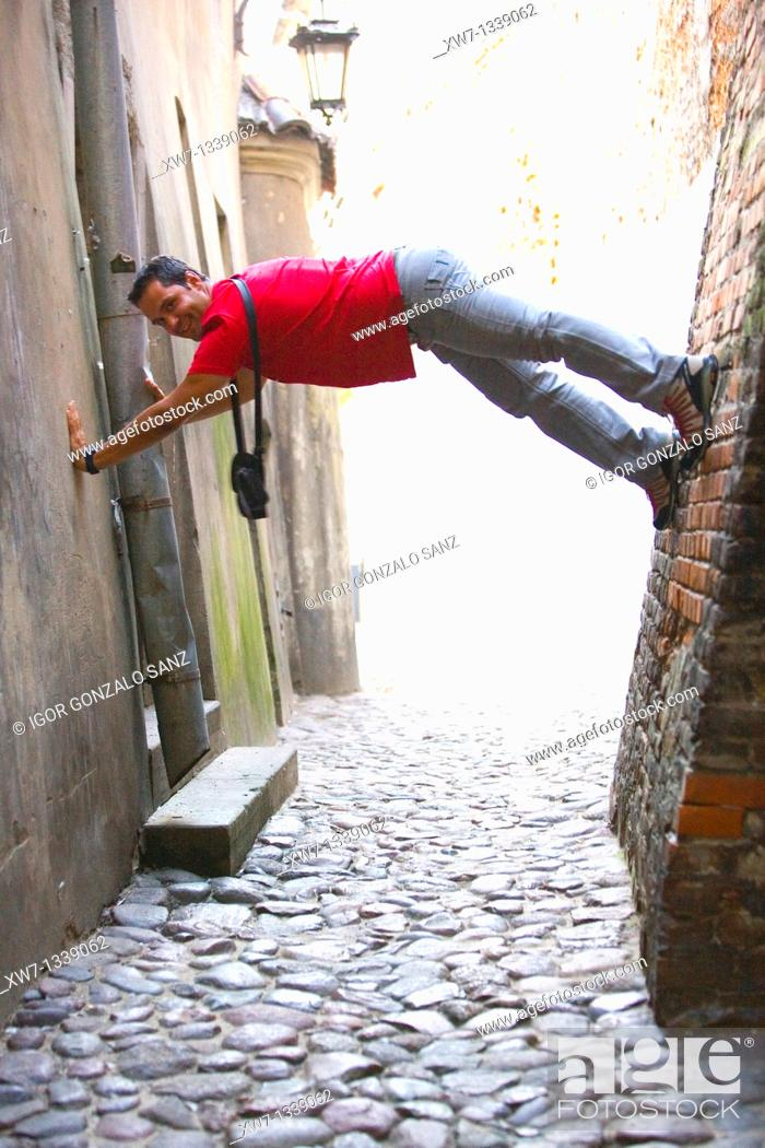 Stock Photo: Lublin, Poland, Tourist having fun in a street of the city centre.