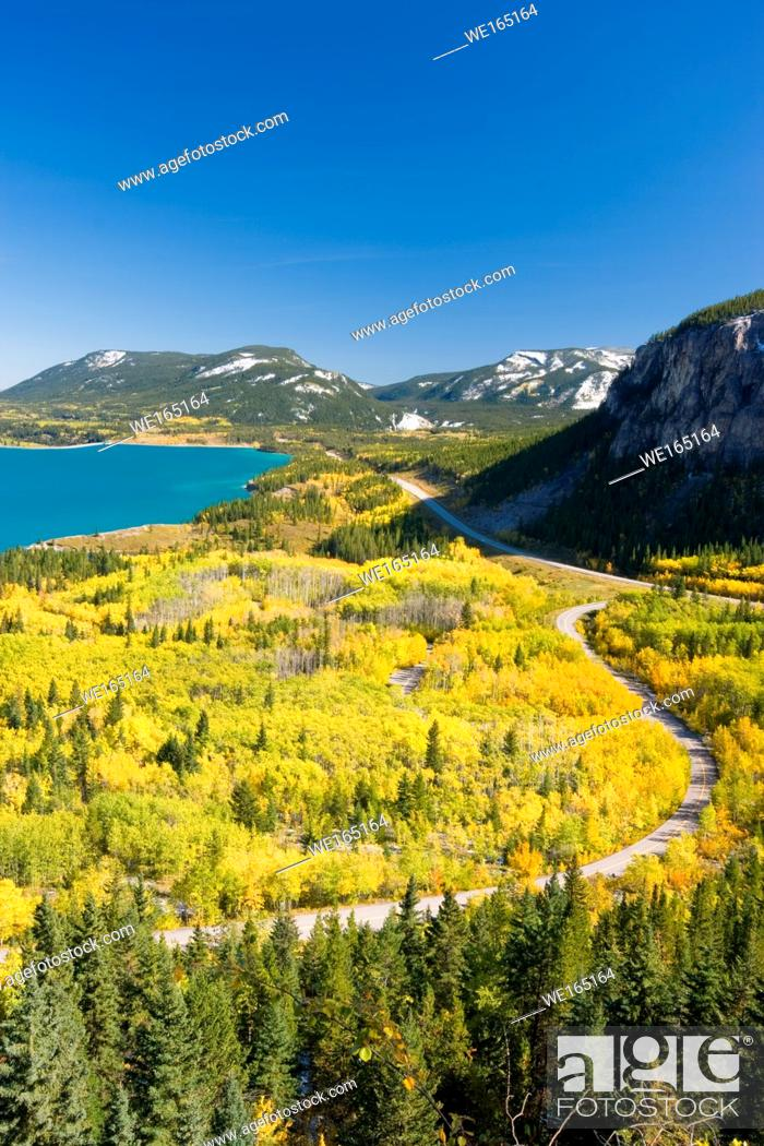 Stock Photo: Turquoise Barrier Lake in fall surrounded by yellow aspen trees. Barrier Lake in Kananaskis Country, Rocky Mountains, Alberta, Canada.