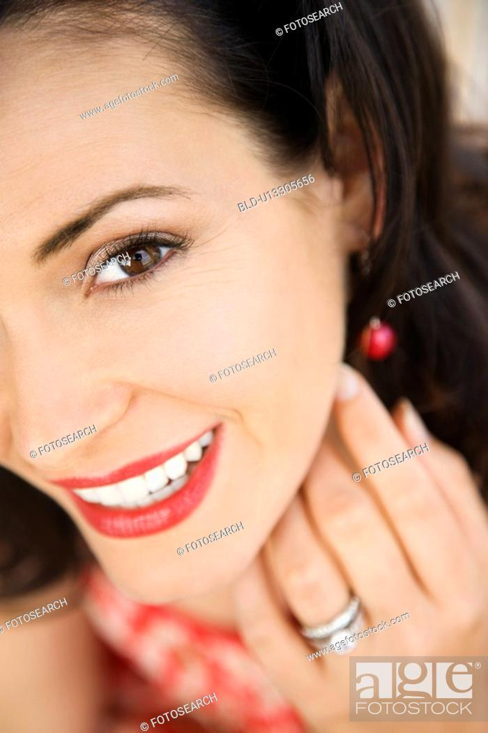 Stock Photo: Close-up of mid-adult Caucasian woman wearing wedding ring.