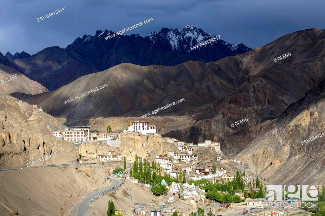 Stock Photo: Ancient Bononian Buddhist monastery Lamayuru among the yellow rocks of the gorge, Ladakh, Himalayas, Northern India. View of the village Lamayuru and mountains.