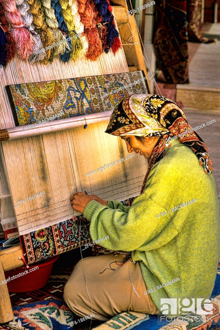 Stock Photo: Portrait of woman making rugs by hand in Istanbul Turkey.