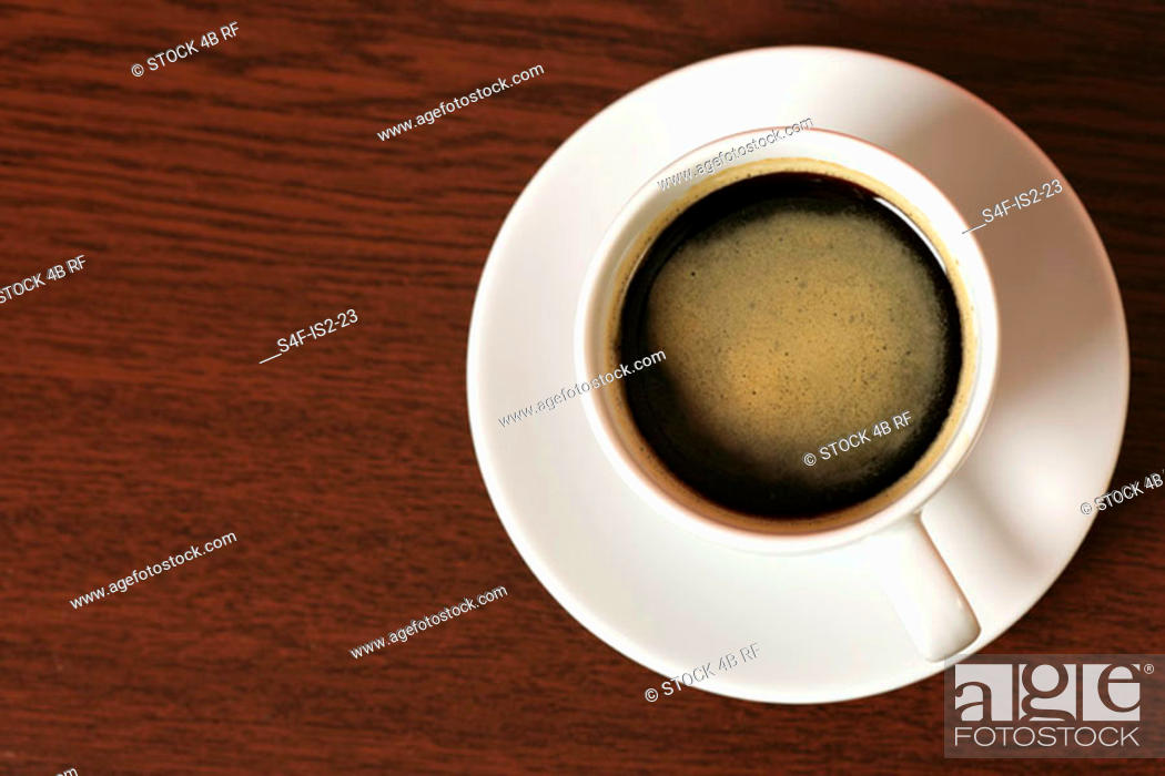 Stock Photo: Coffee cup on a wooden underlay, close-up.