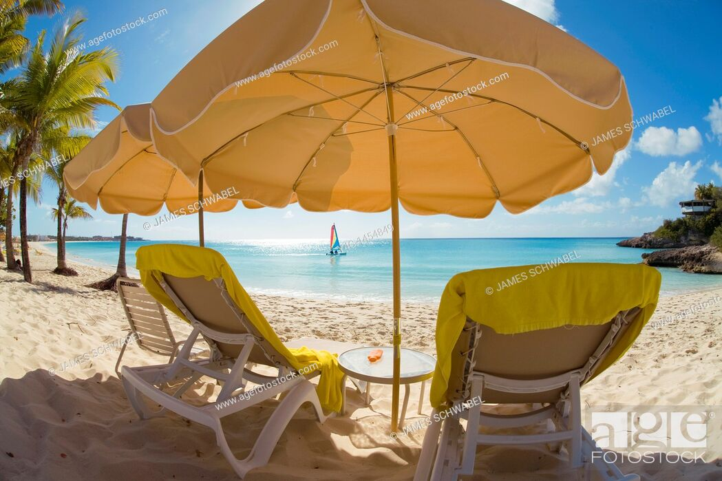 Stock Photo: Beach chairs and umbellas on Meads Bay Beach on the caribbean island of Anguilla in the British West Indies.