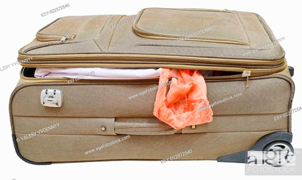 Stock Photo: textile suitcase with fell out female panties.