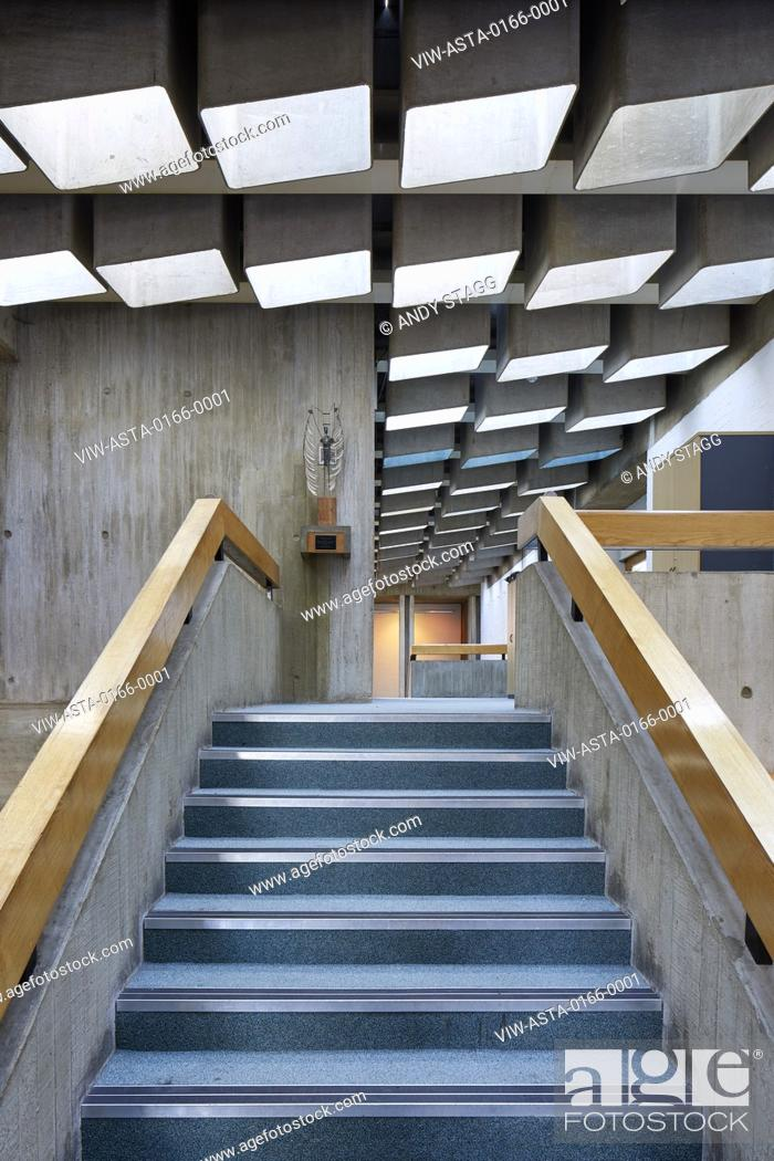 Stock Photo: Concrete stairway from below with light-box rooflights. Leatherhead Theatre, Leatherhead, United Kingdom. Architect: Roderick Ham, 1969.