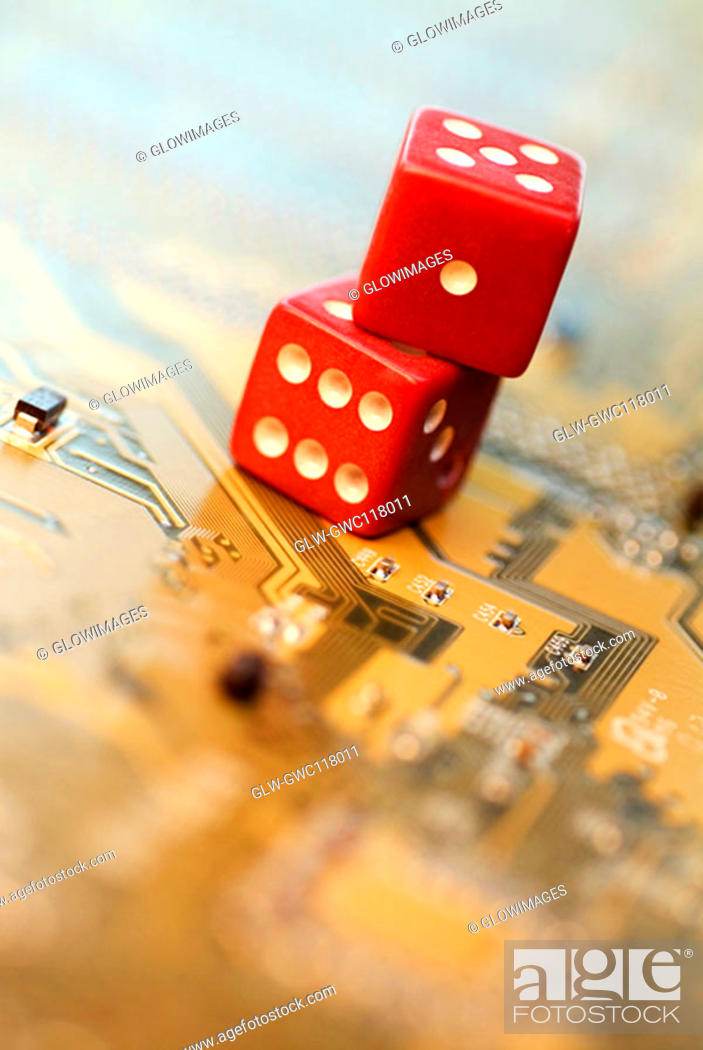 Stock Photo: Close-up of two dice on a circuit board.