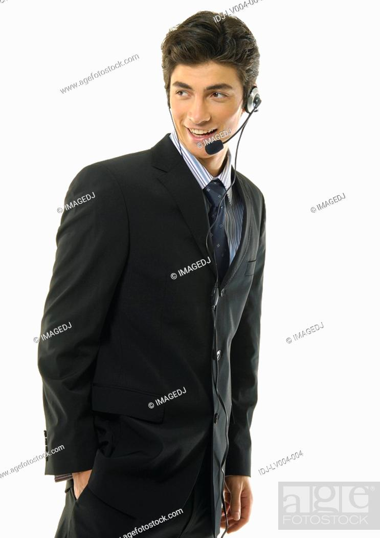 Stock Photo: Businessman wearing headset and smiling.