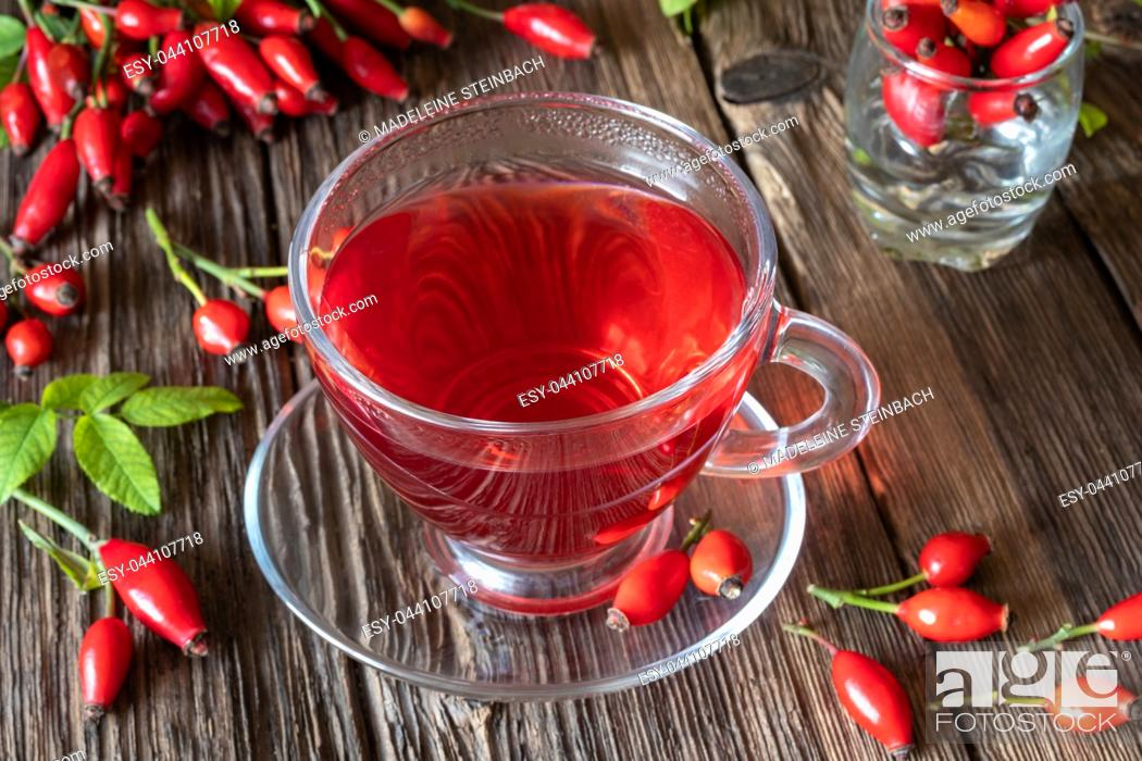Stock Photo: A cup of rose hip tea with fresh berries.