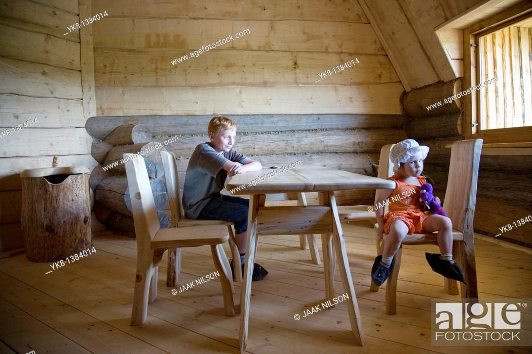 Stock Photo: Serious Emorional Kids, Boy and Girl Sitting at Wooden Table in Old Blockhouse.