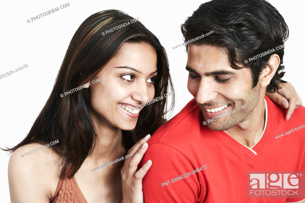 Stock Photo: Close-up of a young couple looking at each other.