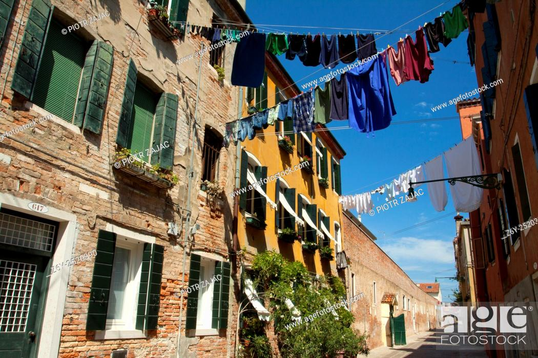 Stock Photo: Hanging lines of drying washing across the street in Venice, Italy.
