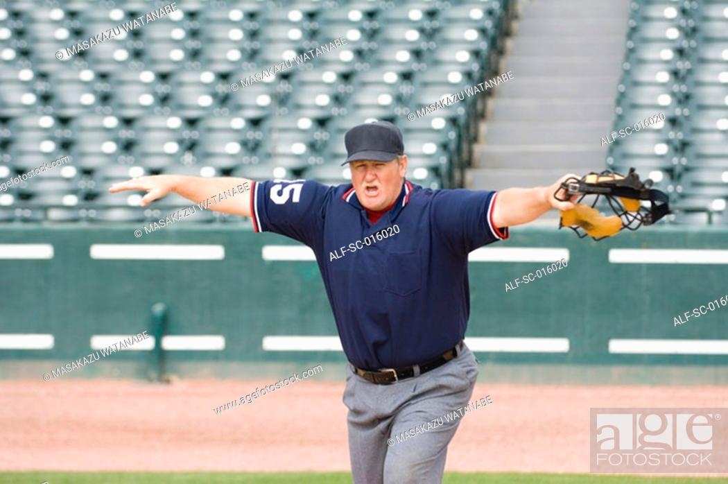 Stock Photo: Umpire calling safe.