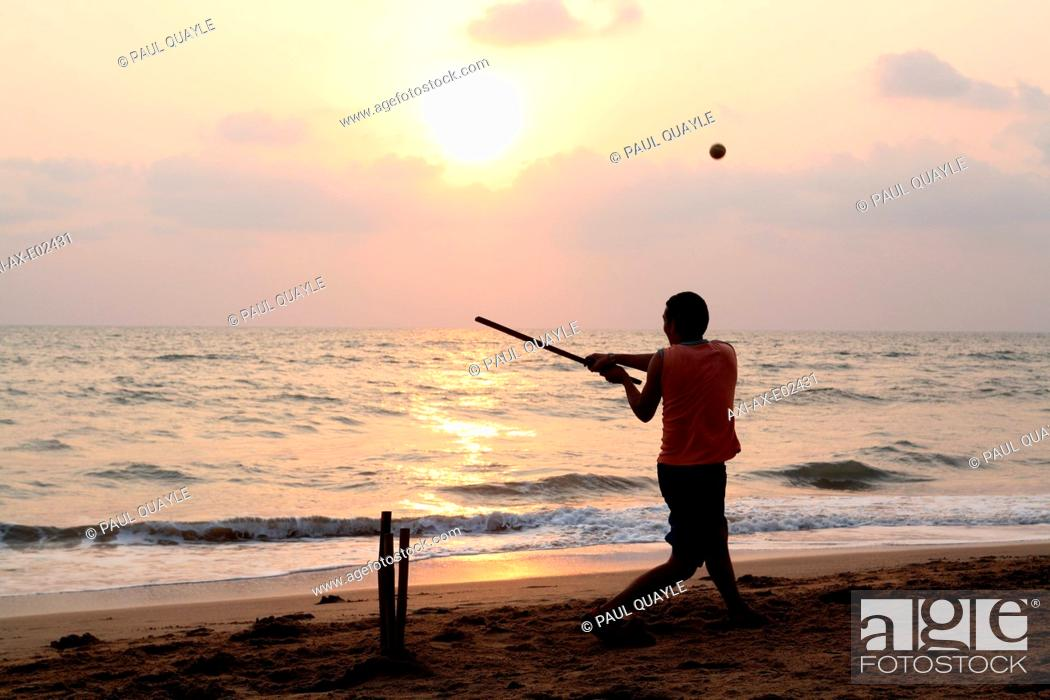 Stock Photo: Playing cricket, the national sport of India, on Anjuna Beach at sunsetGoa State, India, Asia.