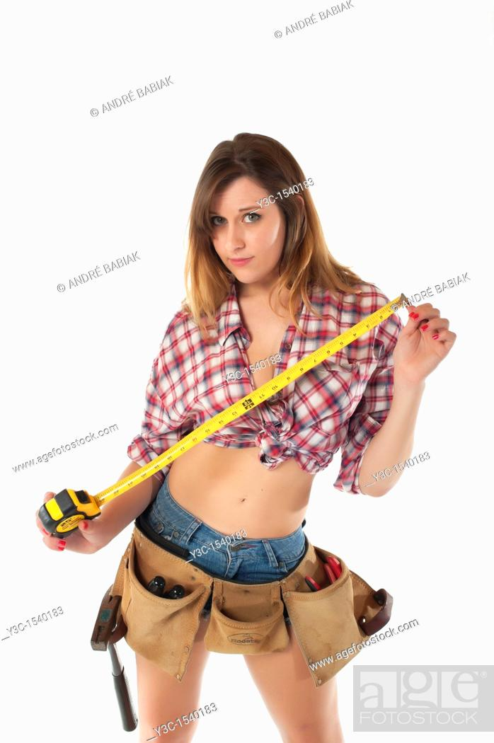 Stock Photo: Do it yourself woman with measuring tape.