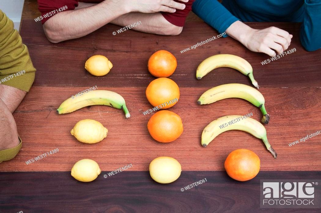 Stock Photo: Raw fruits on wooden floor.
