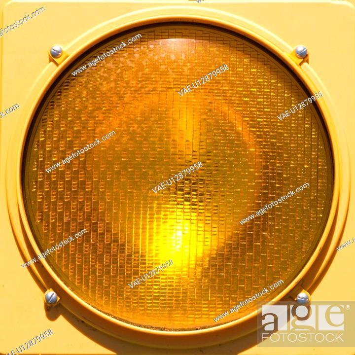 Stock Photo: Closeup of yellow traffic stoplight.