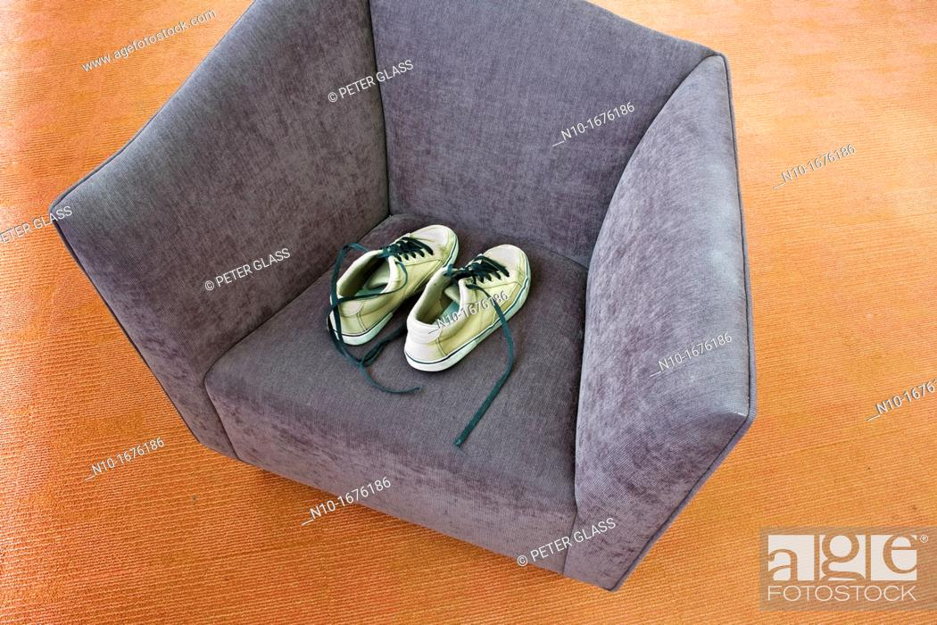 Stock Photo: Pair of man's shoes on a chair.