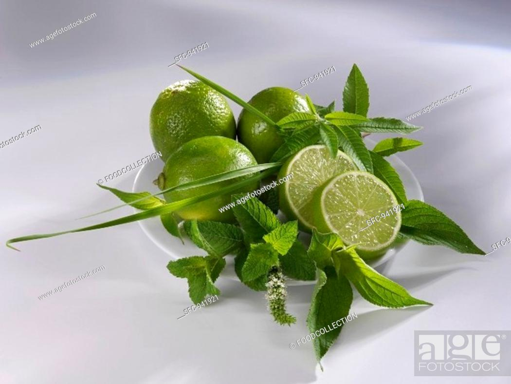 Stock Photo: Limes and assorted herbs on a plate.