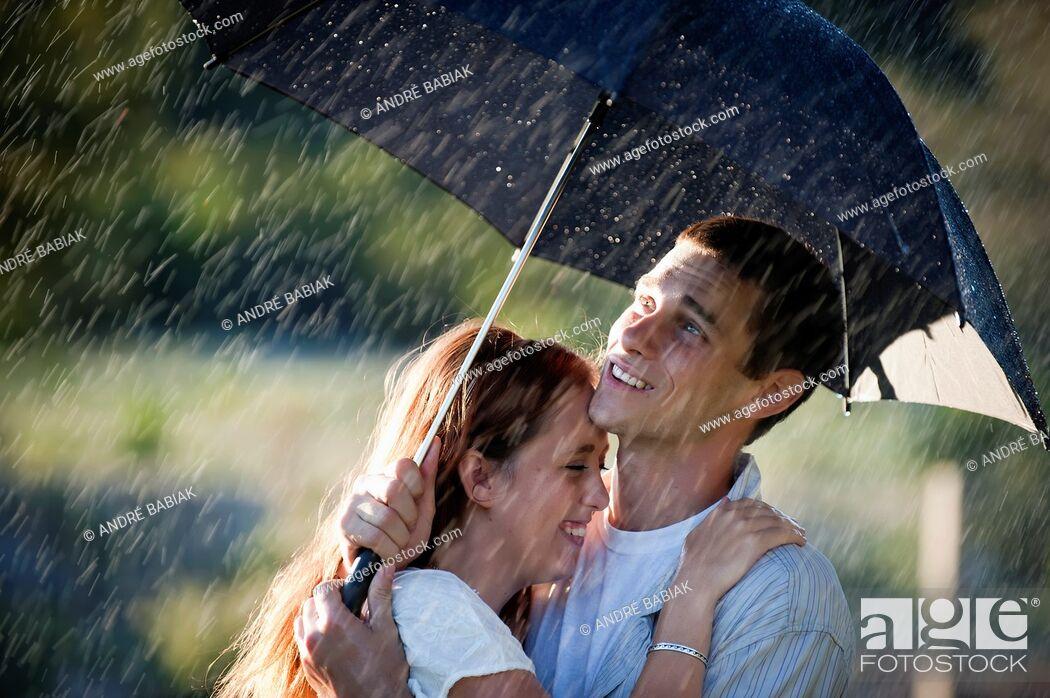 Stock Photo: Couple in love in the rain.