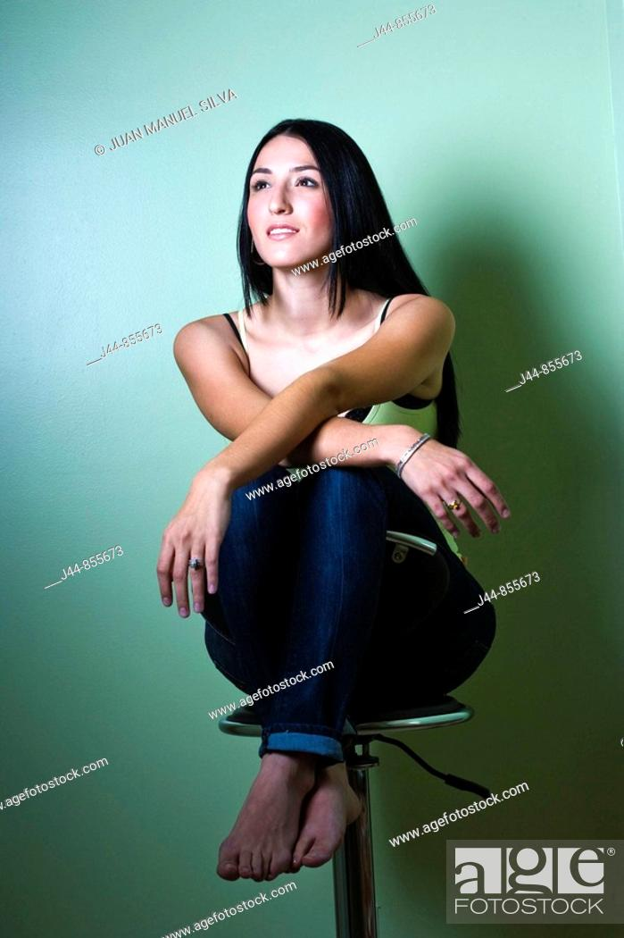 Stock Photo: Woman sitting on an office chair, smiling portrait.