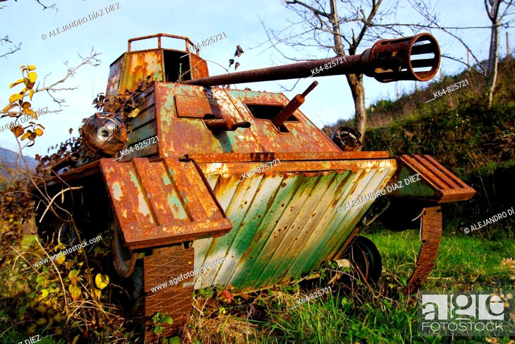 Stock Photo: Old tank handmade toy, rusty. Potes, Cantabria, Spain.