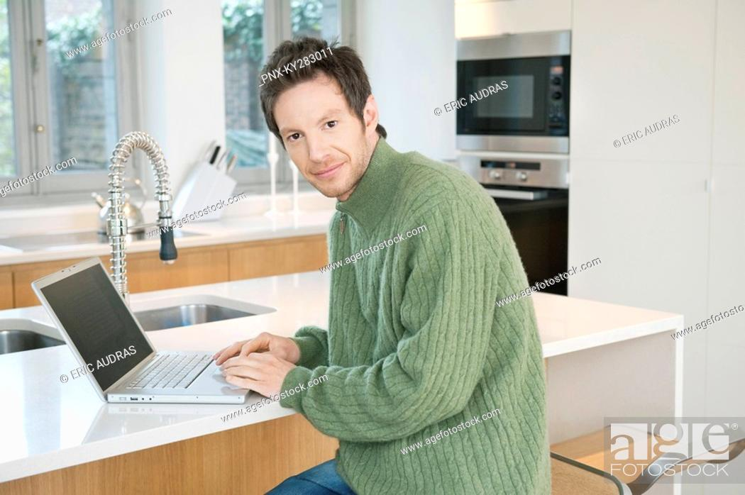 Stock Photo: Portrait of a man working on a laptop.