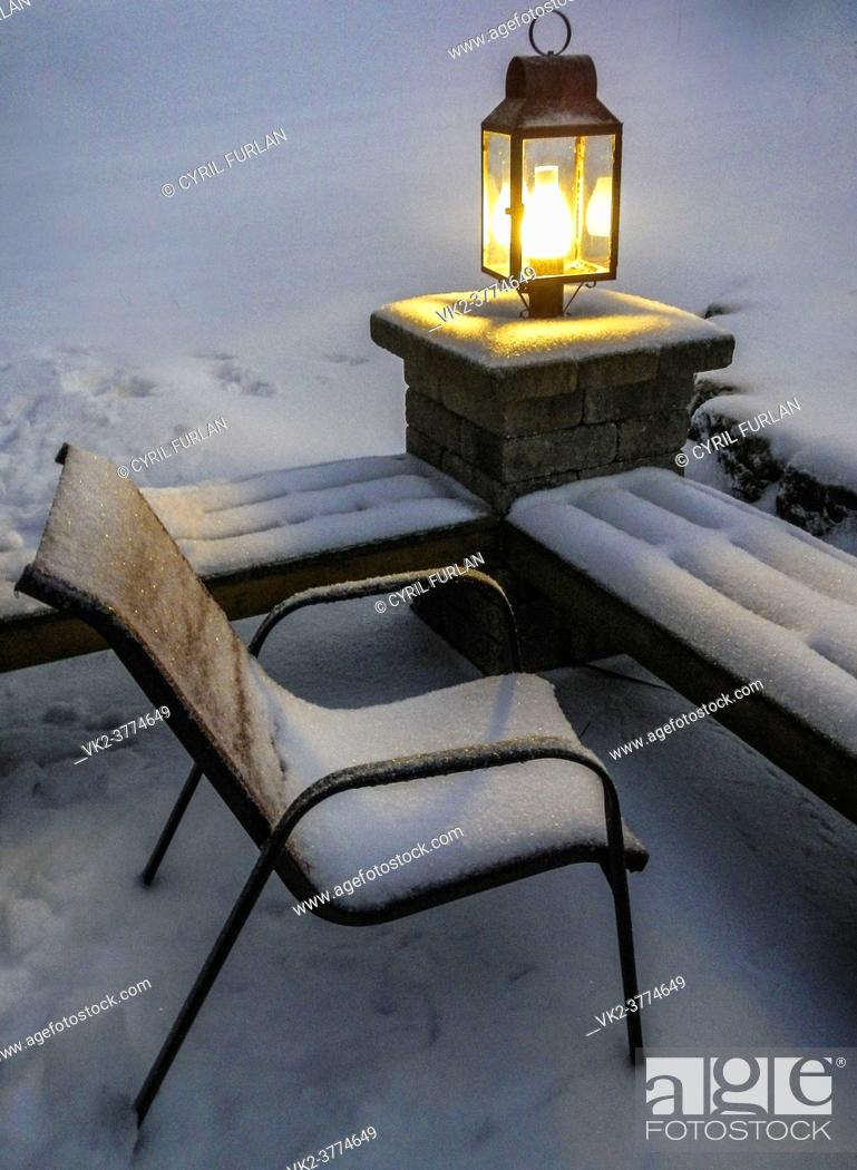 Stock Photo: Frozen summer patio in winter at twilight.