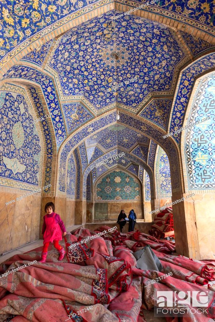 Stock Photo: Girl walking over carpet inside Imam Mosque, Isfahan, Iran.