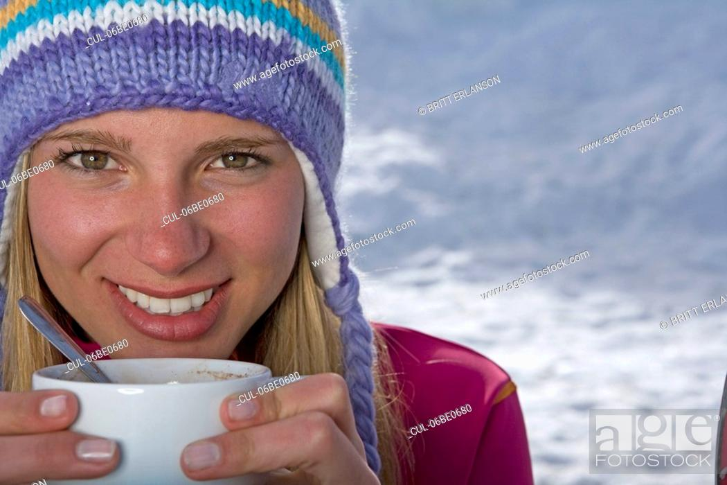 Stock Photo: Girl holding cup of tea.