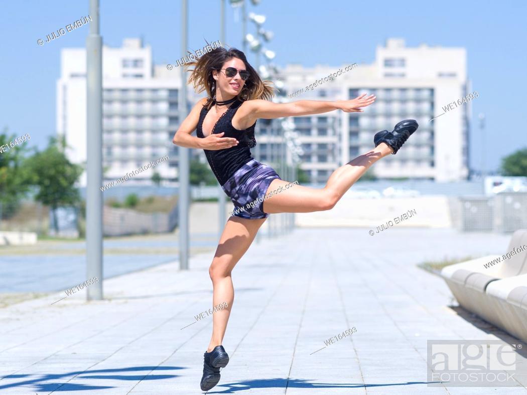 Photo de stock: young ballerina dances and jumps on the street of a city. In Zaragoza, Aragón, Spain.