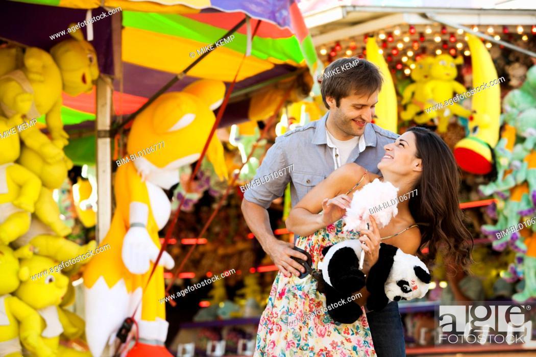 Stock Photo: Caucasian couple enjoying carnival.