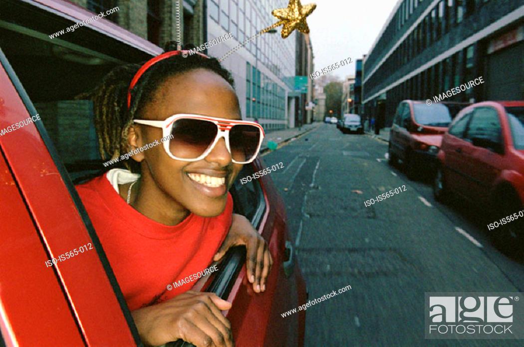 Stock Photo: Smiling woman wearing sunglasses.