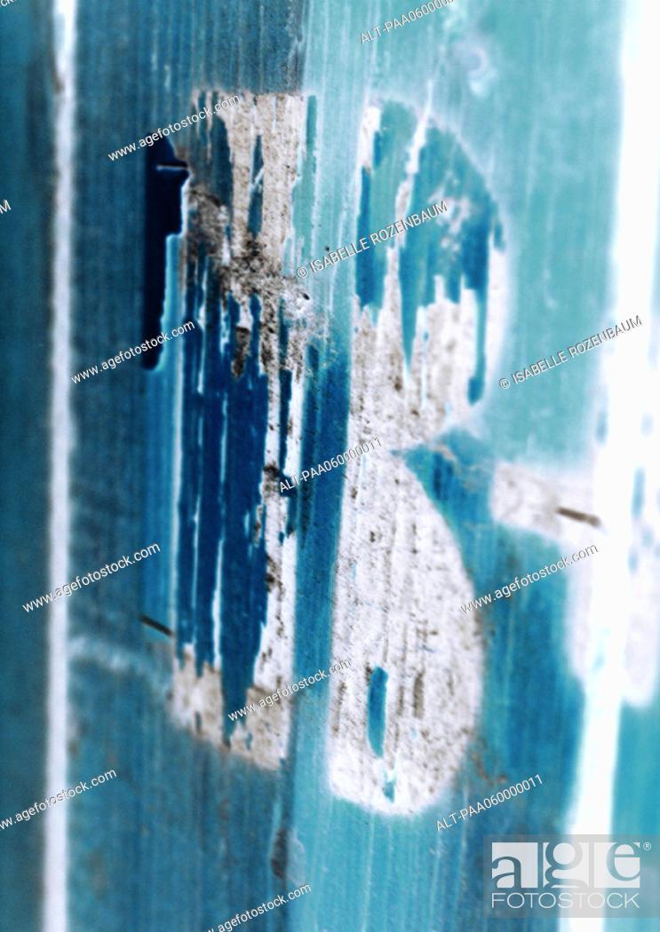Stock Photo: 'B' text, worn away, close-up.