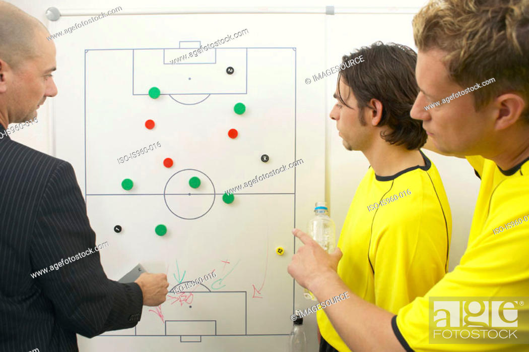 Stock Photo: Coach and soccer players discuss strategy.