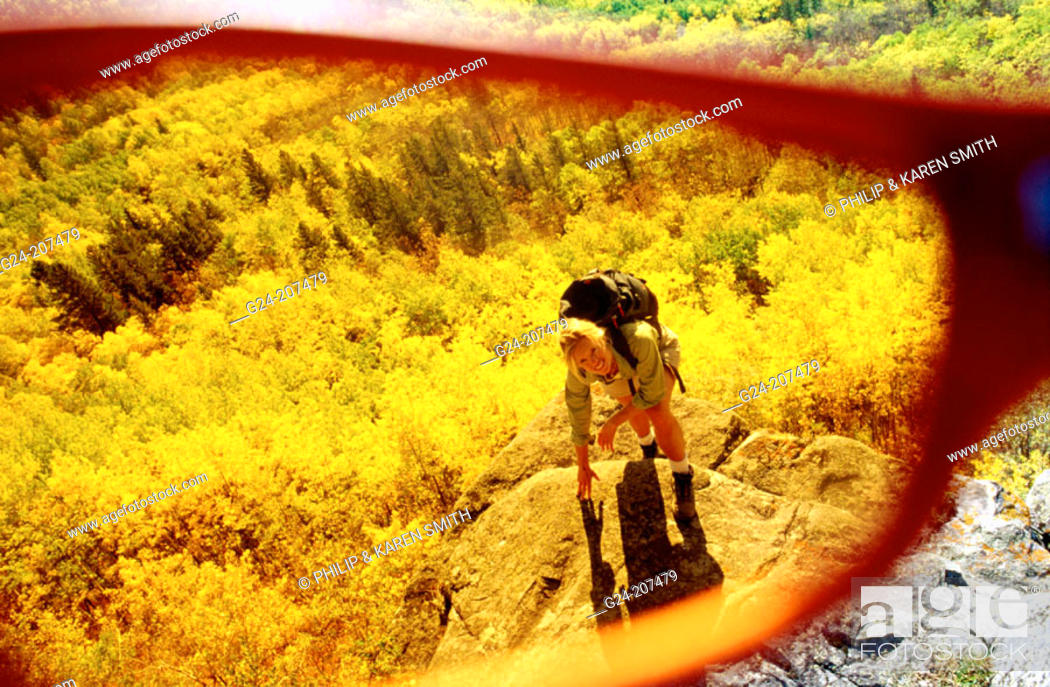 Stock Photo: Hiker and autumn colors, view thru lens of sunglasses.