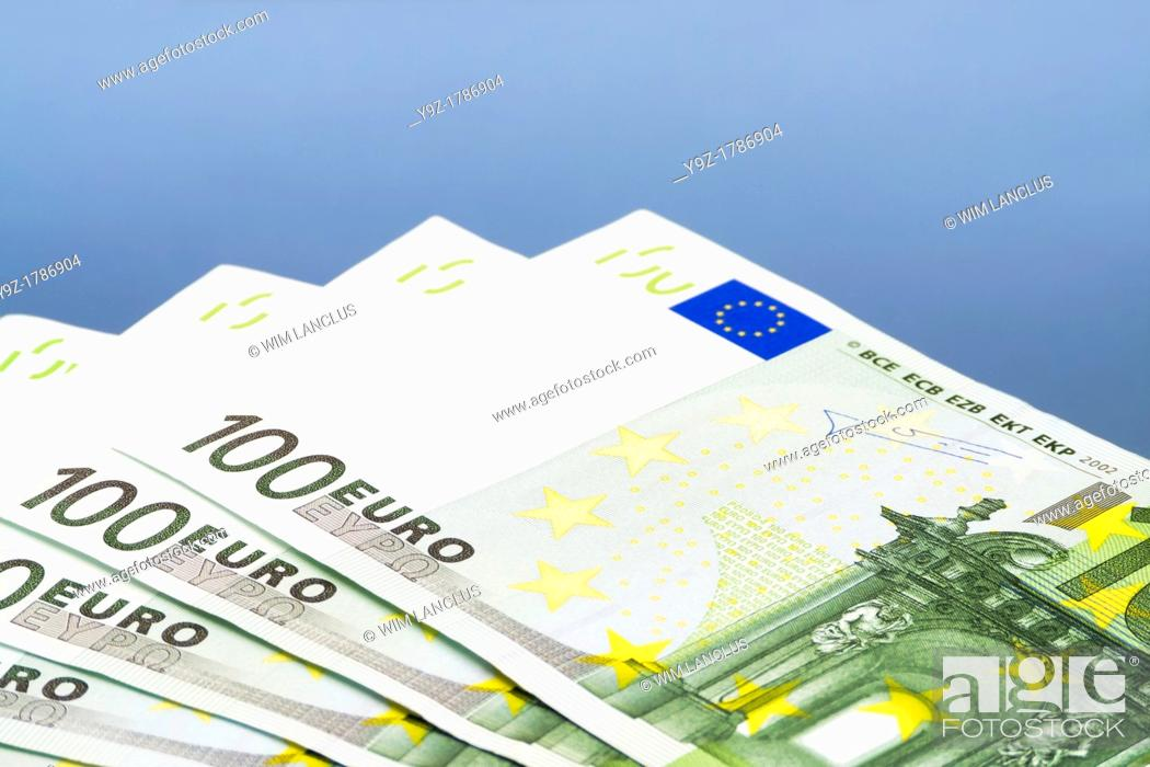 Stock Photo: Euro Bills One Hundred on blue background.