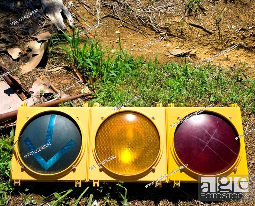 Stock Photo: Old traffic light on ground.