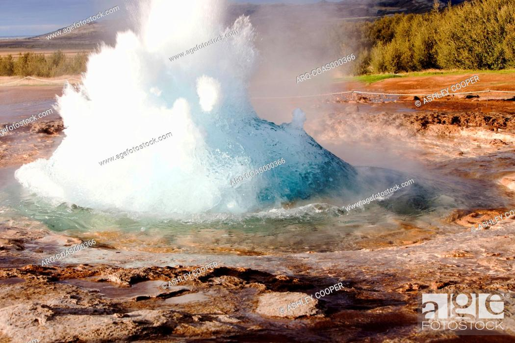 Stock Photo: A geyser at Geysir in Iceland, the place after which all the worlds geysers are named.