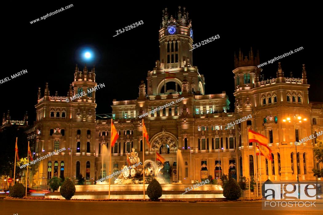 Stock Photo: The full Moon rises over the Palacio de Cibeles (1919) built by Antonio Palacios to house the headquarters of the postal service until 2007 when it became the.