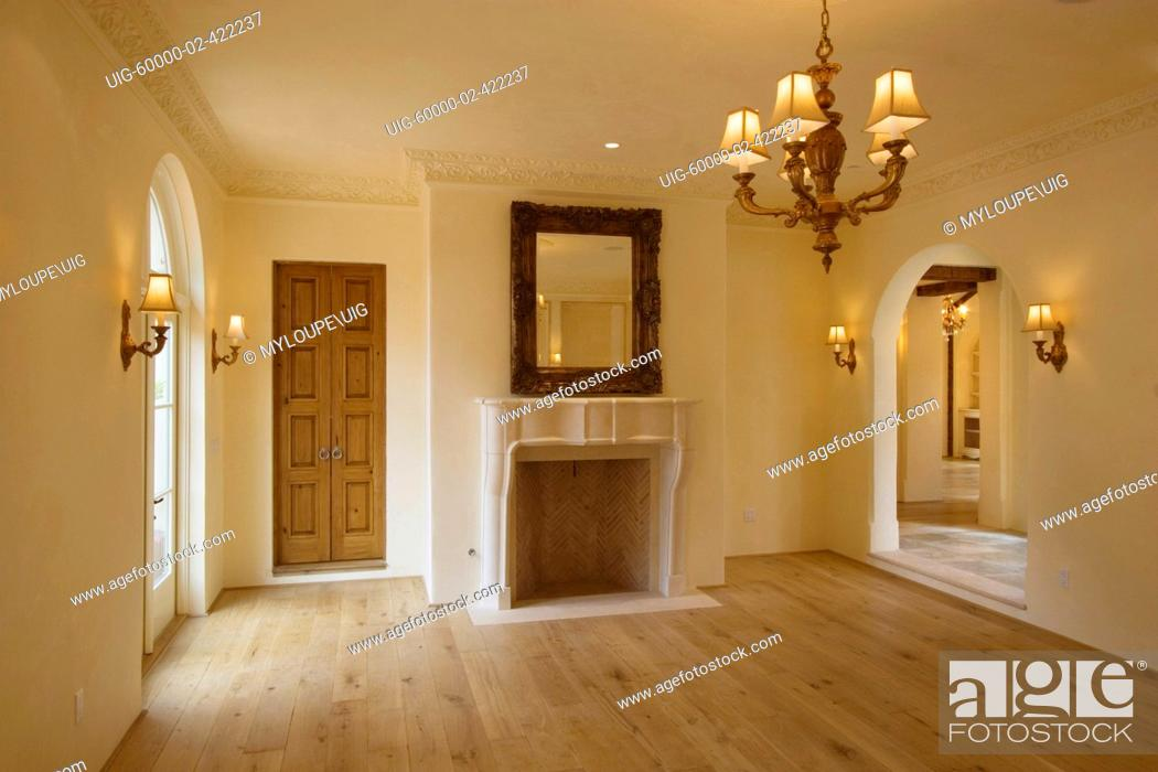 Stock Photo Formal DINING ROOM With Fireplace Hardwood Floors And Interior Lighting