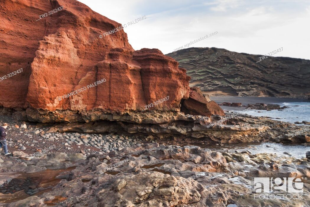 Stock Photo: The eroded rocky levels of the volcanic red mountain. El Golfo, Lanzarote. Spain.