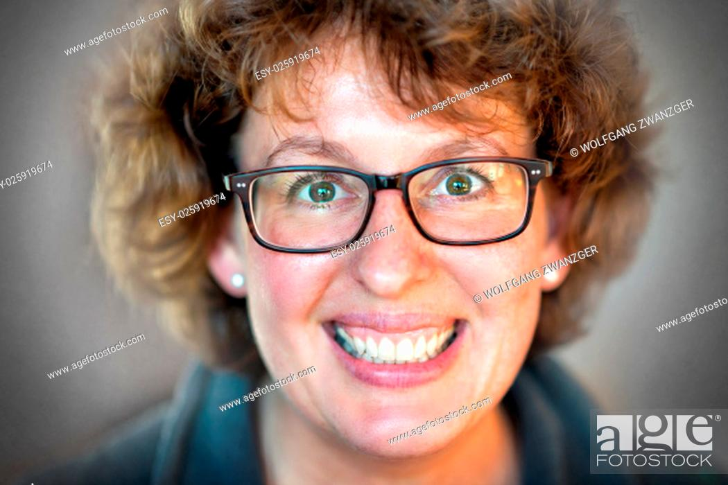 Stock Photo: Closeup image of a laughing happy woman with glasses.