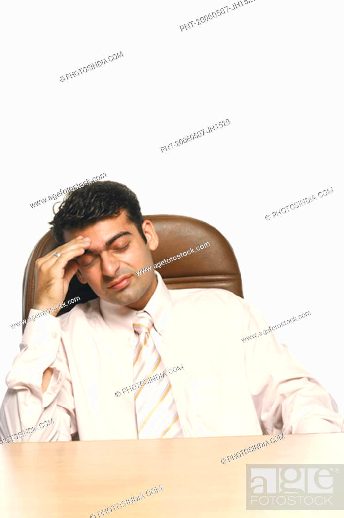 Stock Photo: Businessman with his head in his hand.