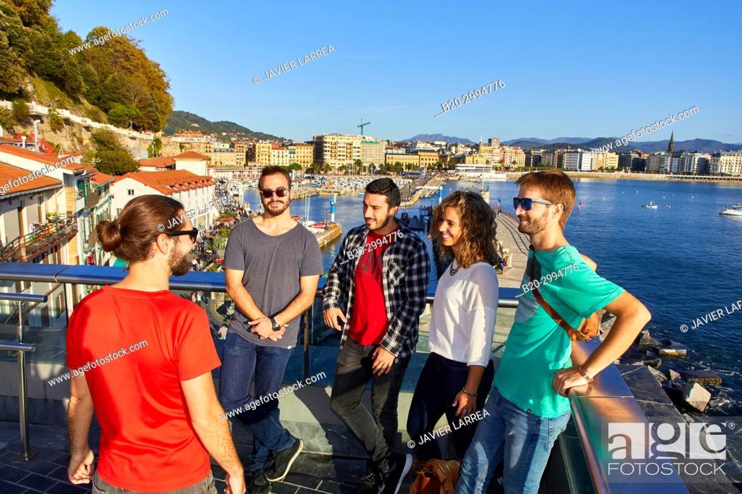Stock Photo: Group of tourists and guide making a tour of the city, Port, La Concha Bay, Donostia, San Sebastian, Gipuzkoa, Basque Country, Spain, Europe.