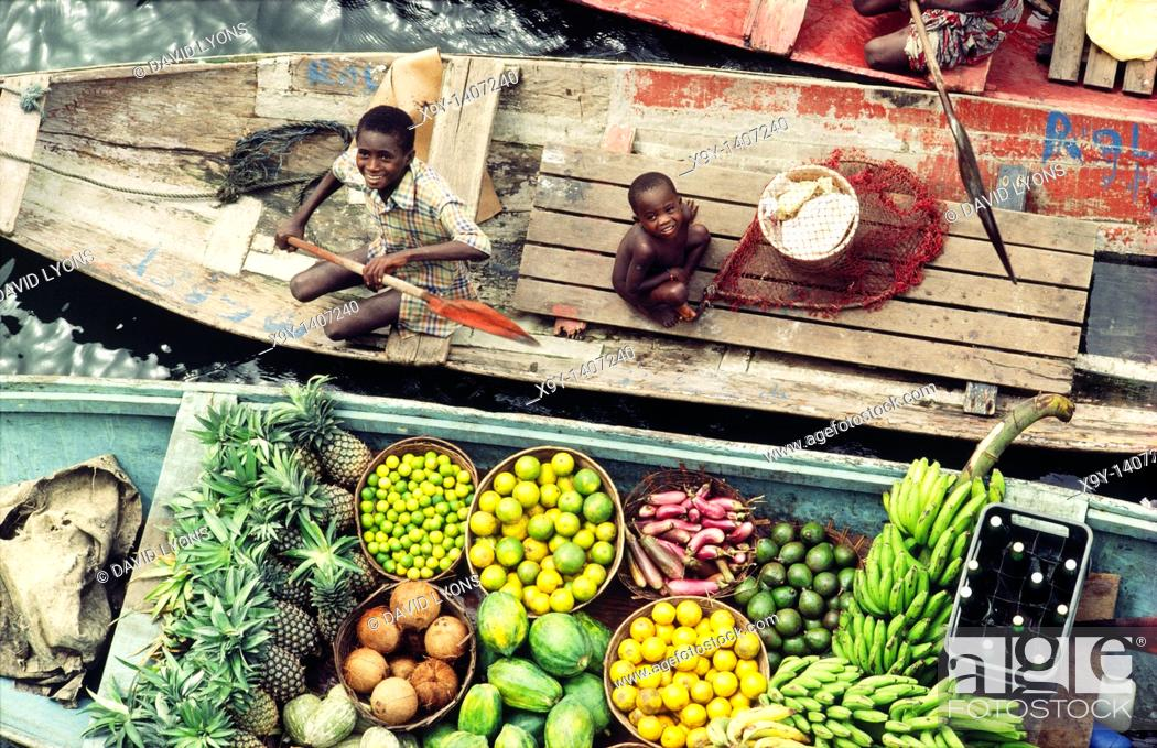 Stock Photo: River Niger delta, Bendel State, Nigeria  Boys sell fruit and beer from canoes at Bennett Island Anchorage on the Warri channel.