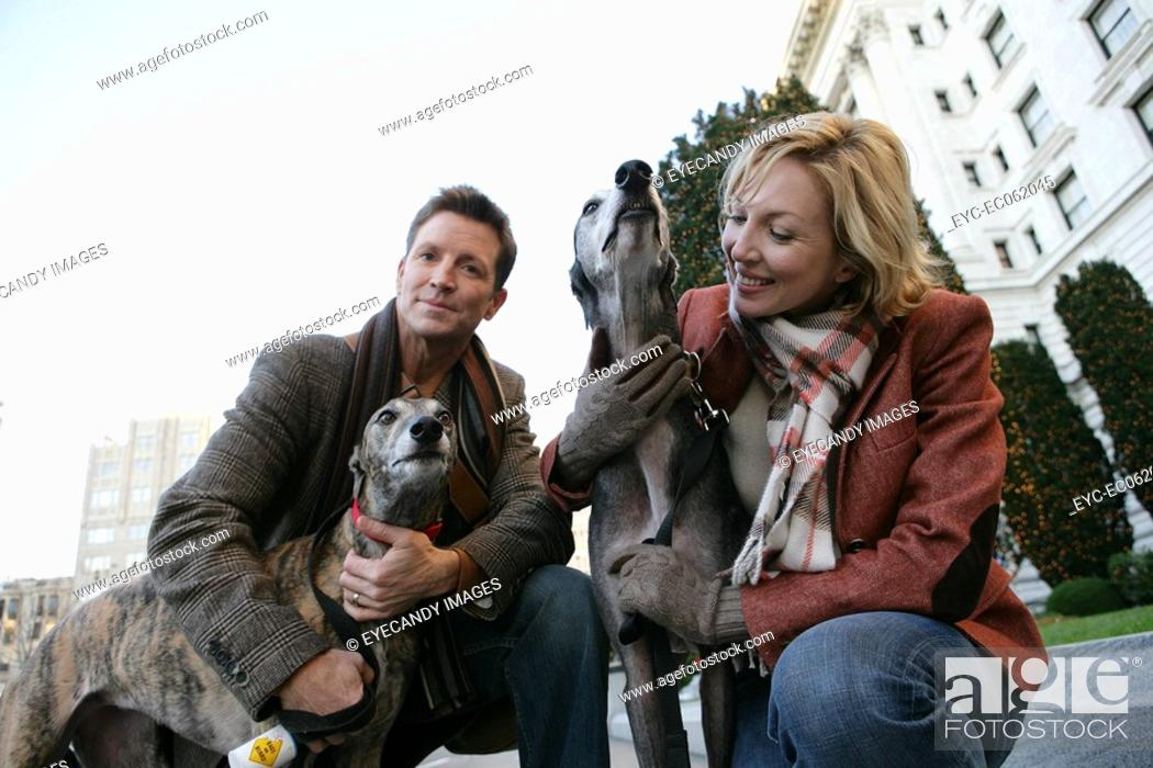 Stock Photo: Couple with dogs.