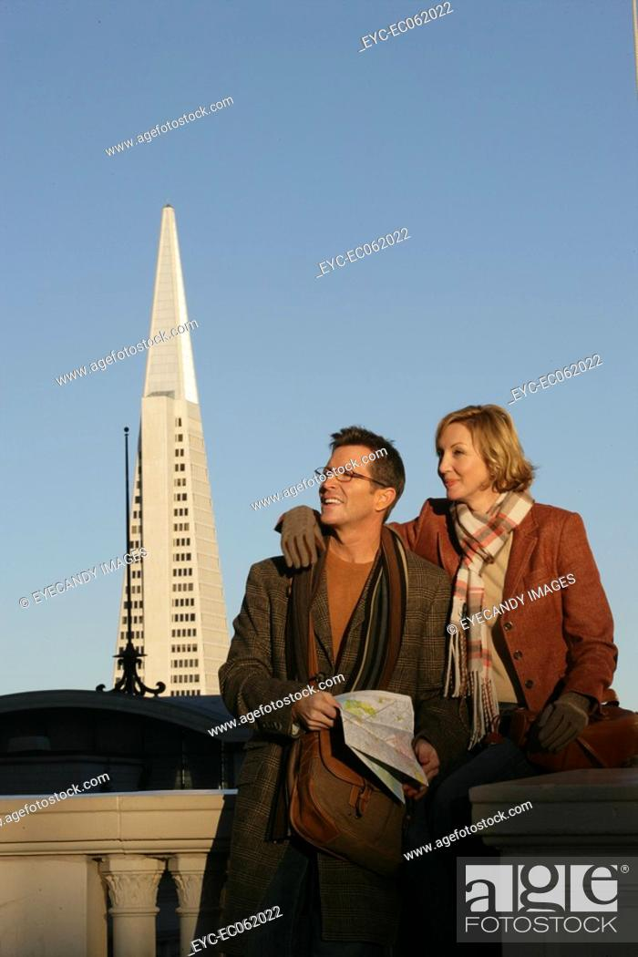 Stock Photo: Mature couple with Transamerica Pyramid in the background.